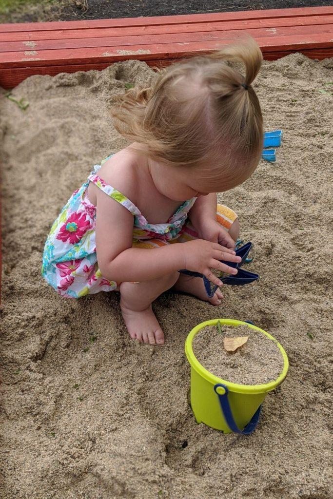 photo of my toddler playing in the sandbox