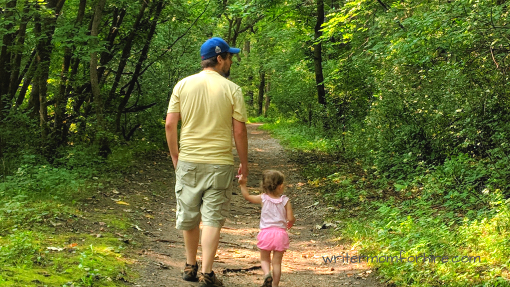 photo of dad and daughter on a family nature hike