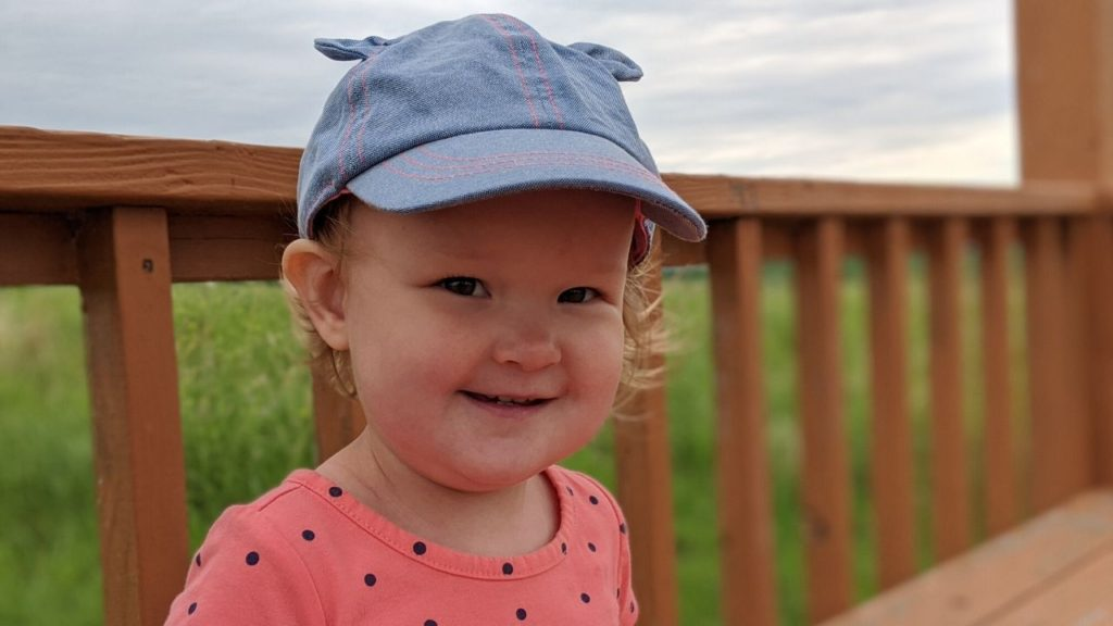photo of my baby with her sunhat on | baby road trip packing list