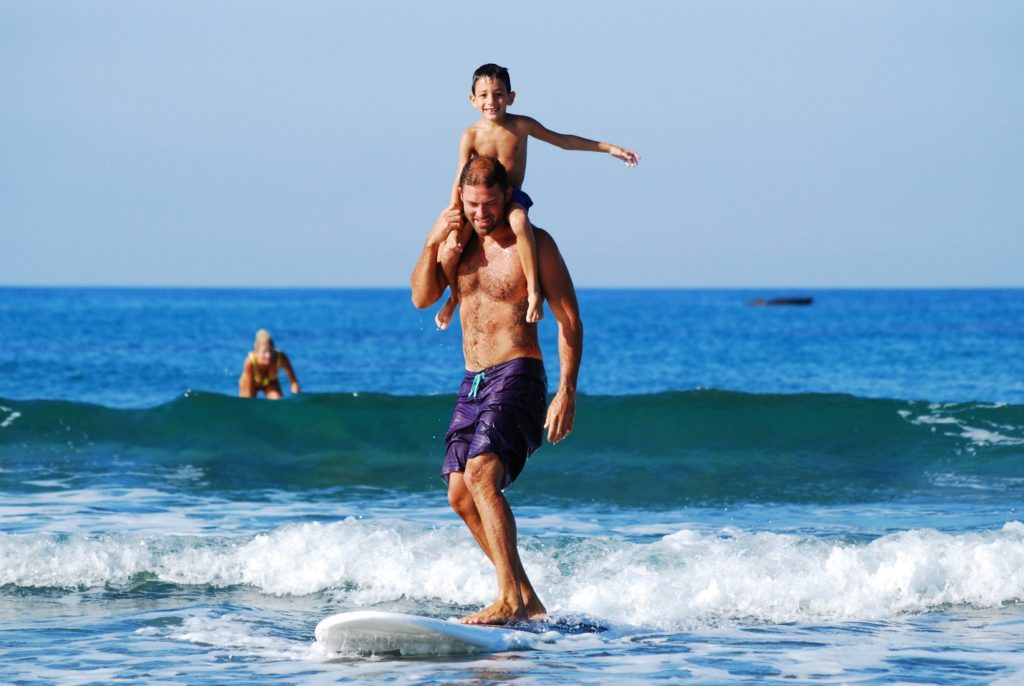 photo of family surfing during travel