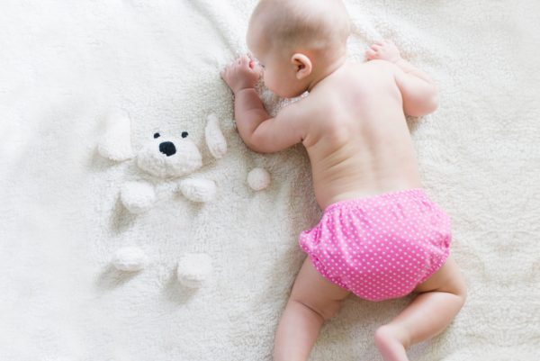 photo of baby wearing a cloth diaper