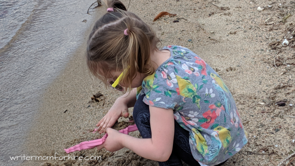 photo of girl playing on beach | benefits of outdoor time for kids + outdoor activities for kids