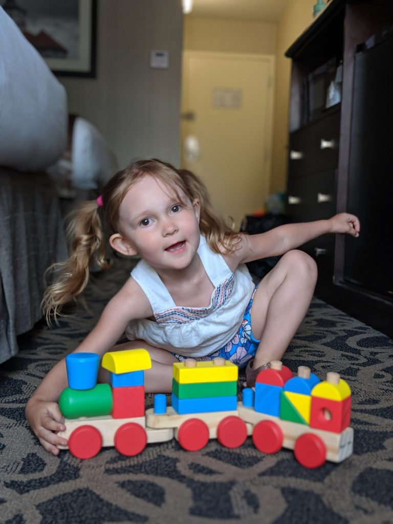 image of toddler in a hotel room