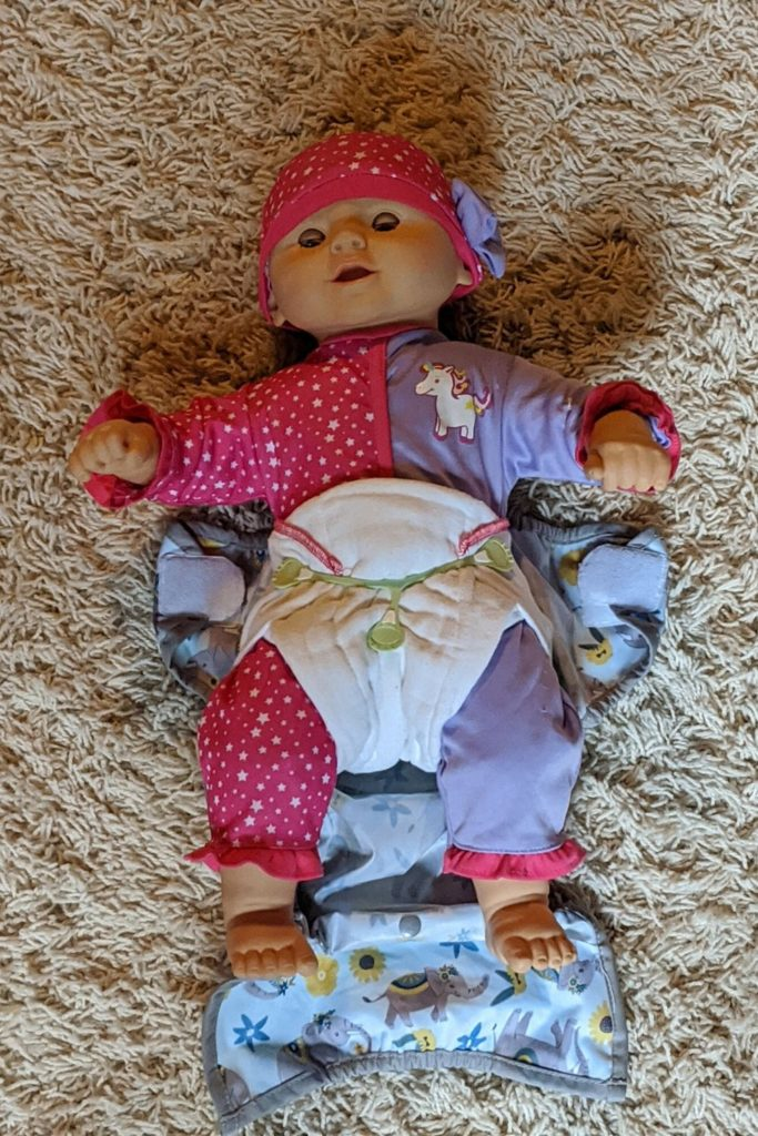 photo of doll wearing a cloth diaper